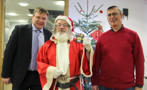 Pictured from left: David Coen, Coen Steel, our Golden Ticket Raffle Prize Sponsor; special guest, Santa; John Kelly, member of Croí's Stroke Support Group.