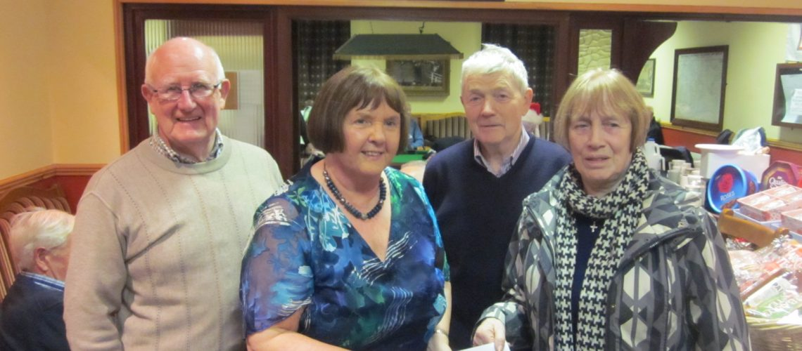 Betty McCarthy presenting the proceeds of the annual Whist Drive in aid of Croí with Croí Ballina Friends Group members Tommy Cronin, Kathleen O' Donnell & Seamus Smyth.